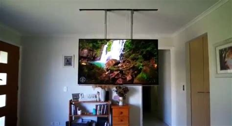 Ceiling drop down TV appears/disappears at push of a button
