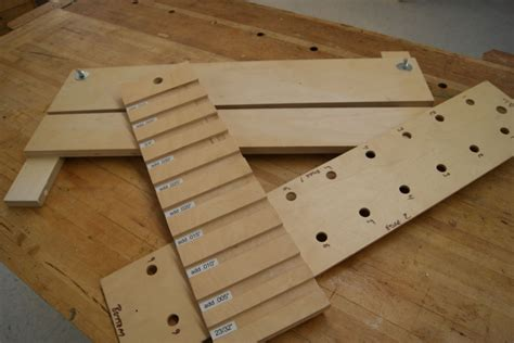 Shop made woodworking jigs rather than commercially produced jigs