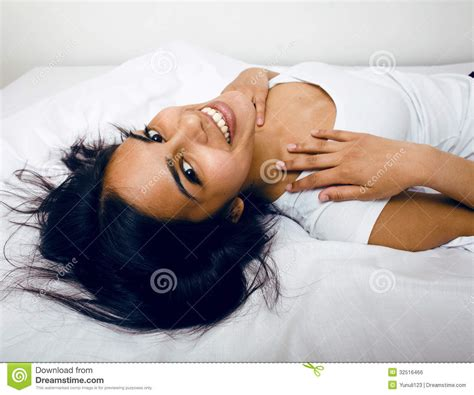 pretty in bed pretty in bed smiling royalty free stock image image 32516466