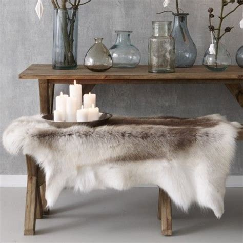 reindeer hide rug sorry rudolph i might be warming to this reindeer rug trend decorator s notebook