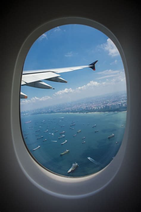 airplane window seat view in flight view through an airplane window singapore