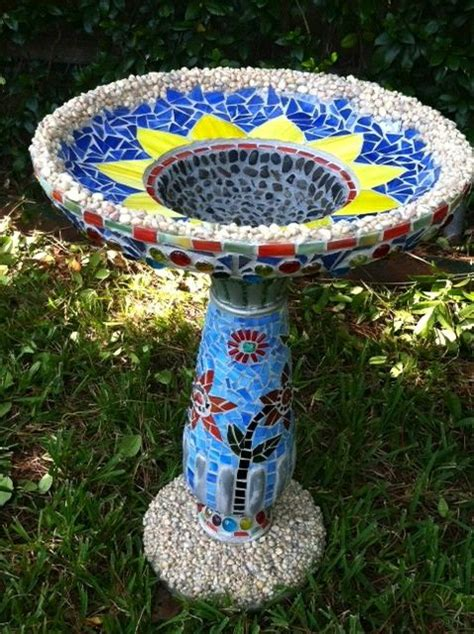 mosaics used from glass stones and beads and grey grout mosaic birdbaths birdhouses