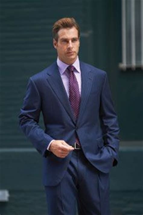 blue suit with purple shirt tie always works