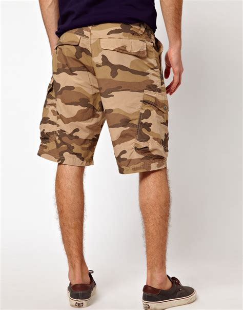 bench camo shorts lyst bench camo cargo short in natural for men