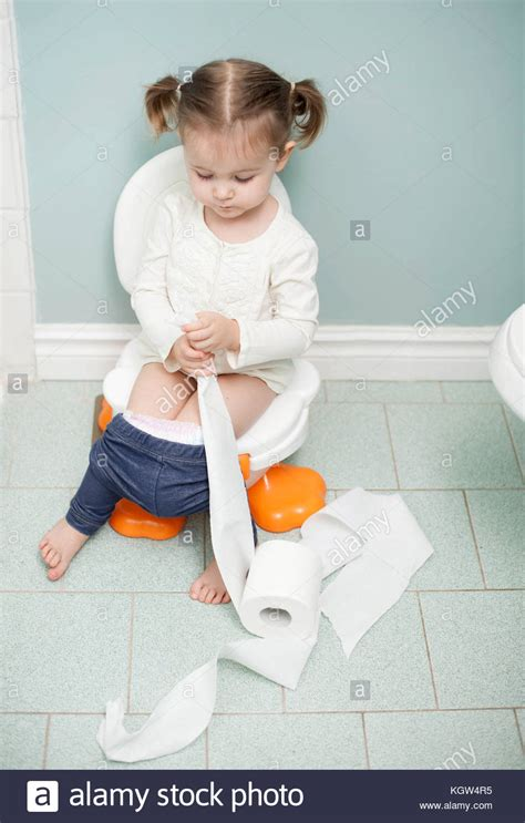 girl on toilet potty training sitting toilet toilet training white stock photos