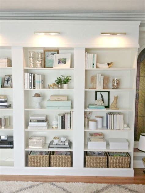 beautiful bookcases beautiful library lights design chic love the baskets