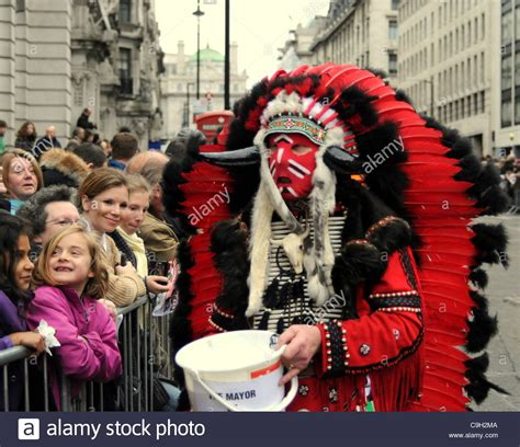 american indian xmas presents that are a donation in a american indian costume collecting money for charity stock photo royalty free