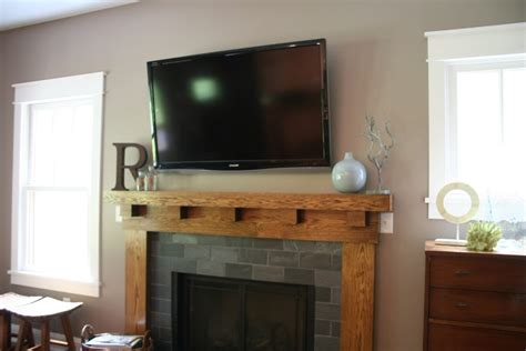 fireplace mantels with tv above centralazdining