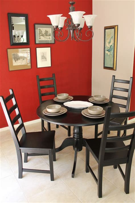 red walls  black dining tables chairs eclectic