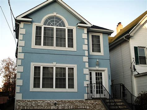 blue stucco house rehauling the exterior of new house how should we