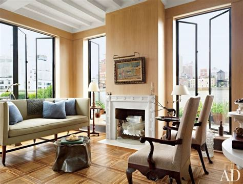 living room george in a new york living room a george iii sofa joins burlap clad antique armchairs and a
