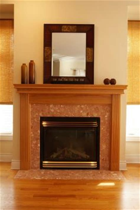 how to attach a mantel on a wood fireplace in a brick wall