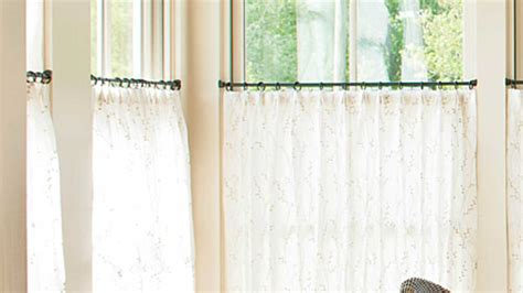 tips for hanging curtains how to hang caf 233 curtains southern living