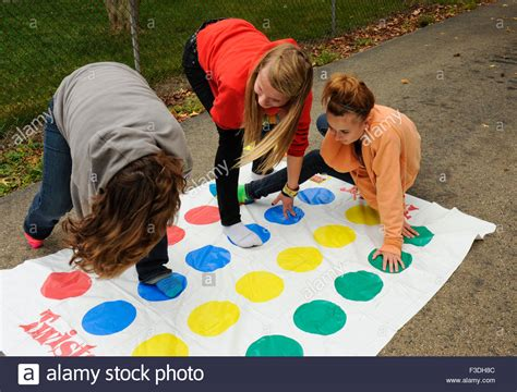 preteen little play teen and pre teen girls playing the floor game of twister