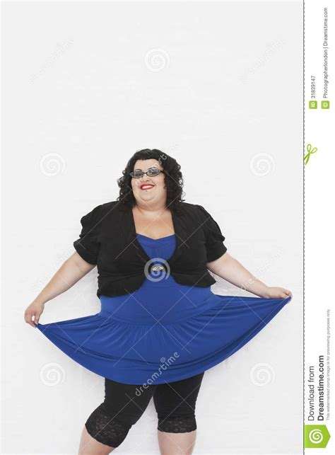how to photograph heavy women overweight woman curtseying royalty free stock photography