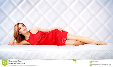 lie on the couch elegant girl lying on the couch stock photos image 30727763