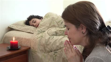 mom son bedroom single mother and son sleeping together or hispanic christian mother praying for her child in bed