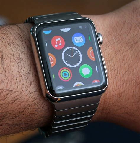 apple watch apple watch hands on the wristwatch just caught up to the