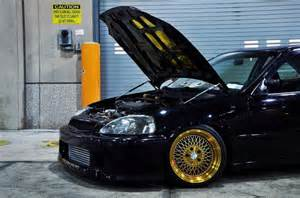 honda civic on sick golden rims rides