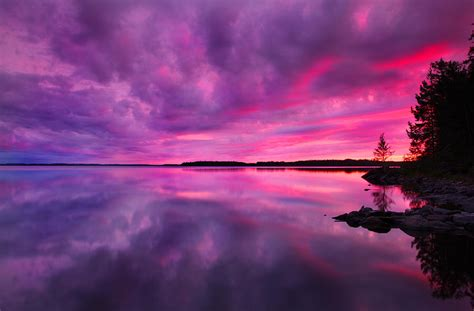 Warm Wall Colors by Dramatic Purple Pink Sunset Over Lake In Finland
