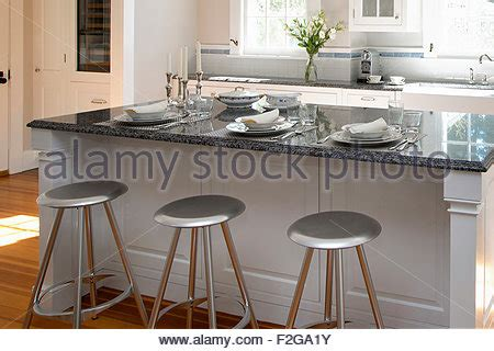 contemporary kitchen islands with seating stools at counter of modern kitchen stock photo royalty
