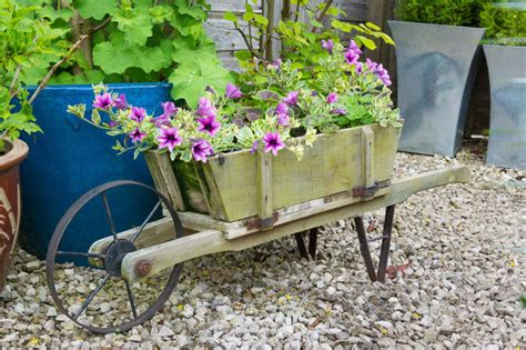 Wheelbarrow Planter Ideas by 27 Wheelbarrow Flower Planter Ideas For Your Yard