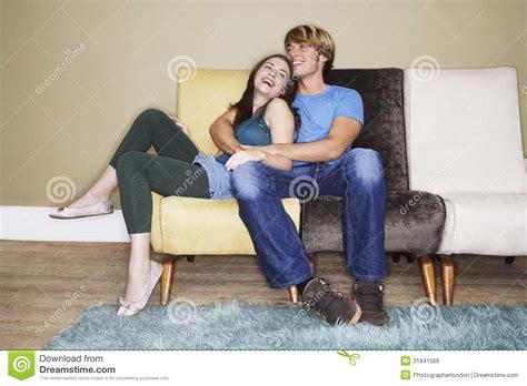 couch couple romantic couple on sofa stock photo image of enjoyment