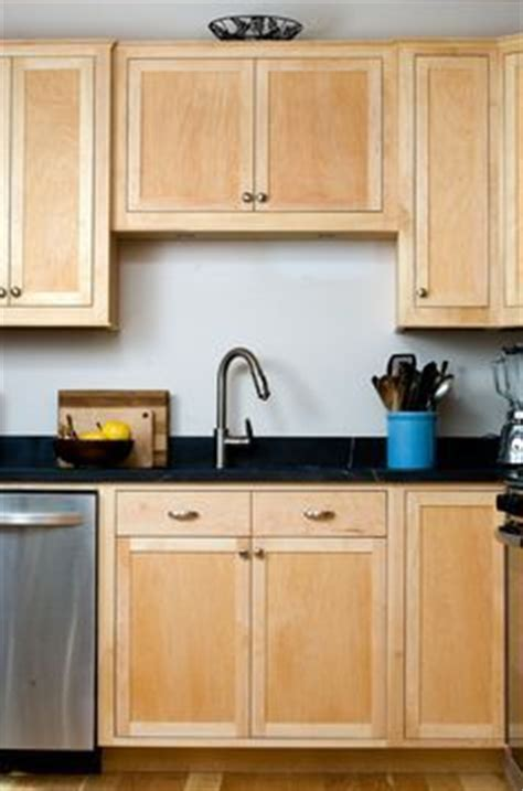 clear coat for cabinets clear coat maple craftsman kitchen with black marble
