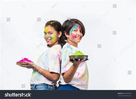 holi special girl image two indian girls celebrating holi gulal stock photo