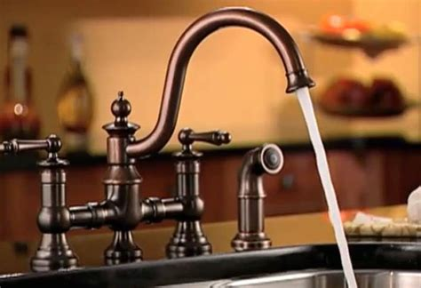 how to install a faucet in the kitchen installing a kitchen faucet and side sprayer at the home depot
