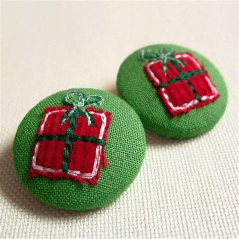 embroidered christmas present buttons by jenny arnott