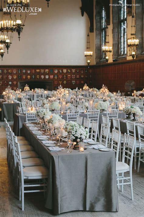 grey runner wedding family style reception with white chiavari chairs gray