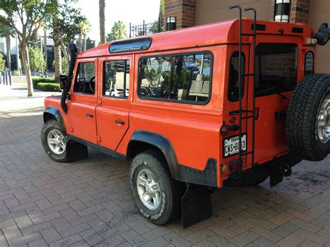 land rover defender diesel 1987 land rover defender 110 diesel manual orange left