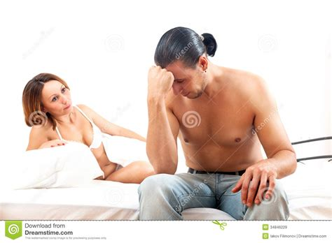 wife in bed middle aged sad man has problem in bed royalty free stock