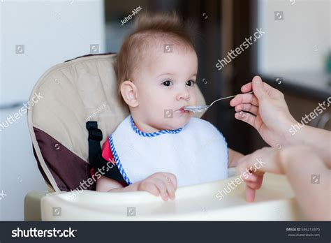 Sits In Chair To Eat by Small Child Sits On Chair Stock Photo 586213370