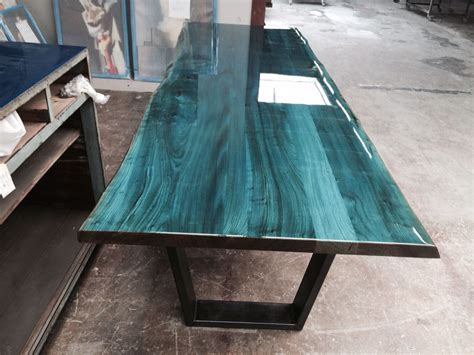 table top epoxy blue on elm tabletop designed and produced by