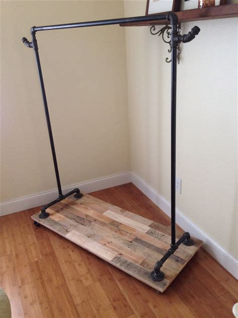 Clothes Racks On Wheels by 25 Best Ideas About Pipe Clothes Rack On