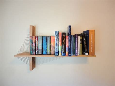 How To Shelf Books by Suspension Shelf Robby Cuthbert Design