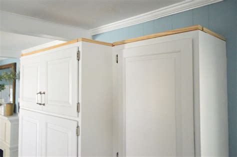 how to add molding to kitchen cabinets how to add crown molding to the top of your cabinets