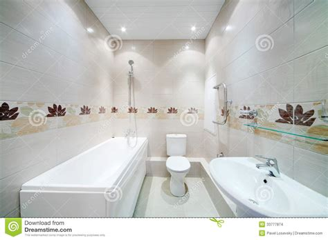 How To Furnish An Apartment clean bathroom with toilet with simple grey tiles stock