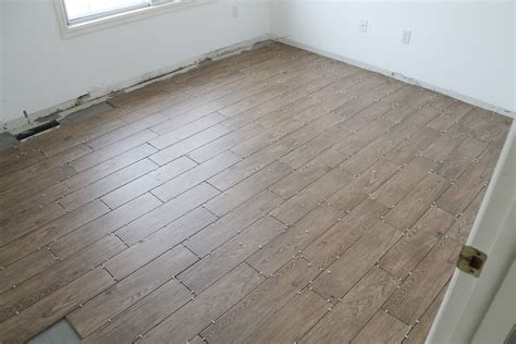 Plank Floor Tile Remodel Small Bedroom Spaces With Wood Plank Floor Tile Painted With Brown Color Ideas