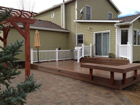 multi level deck and paver patio with cedar pergola