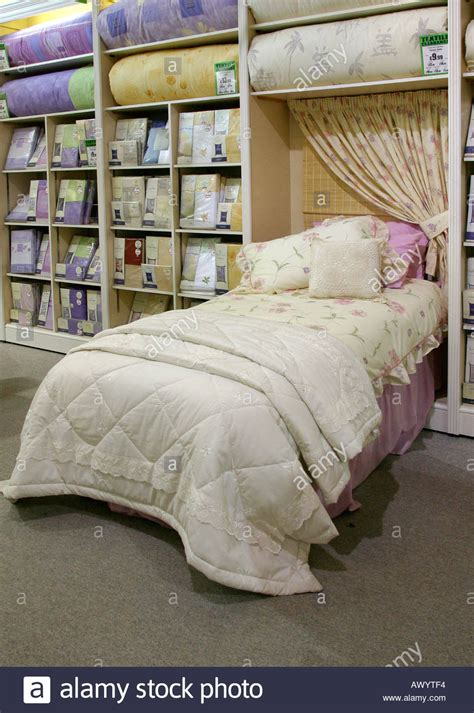 bed linen warehouse duvet cover and bed linen on display in store stock photo