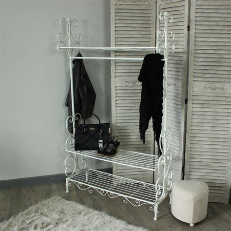 grey ornate vintage style home hanging clothes rail