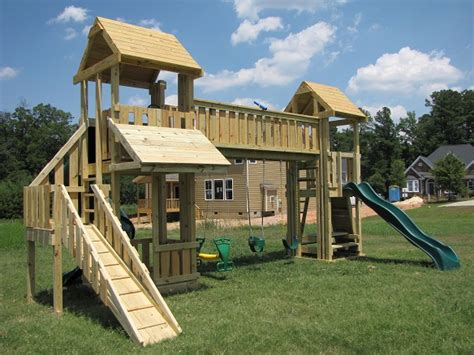 swing set with bridge bridge connecting playhouse and slide kids korner