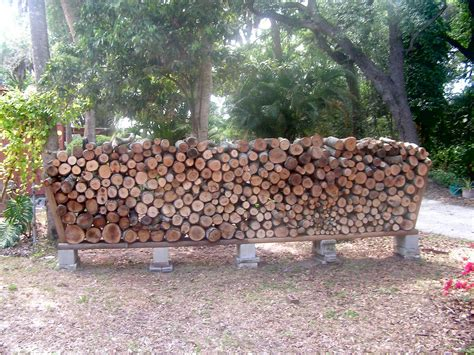 14 easy diy outdoor firewood racks to keep those logs