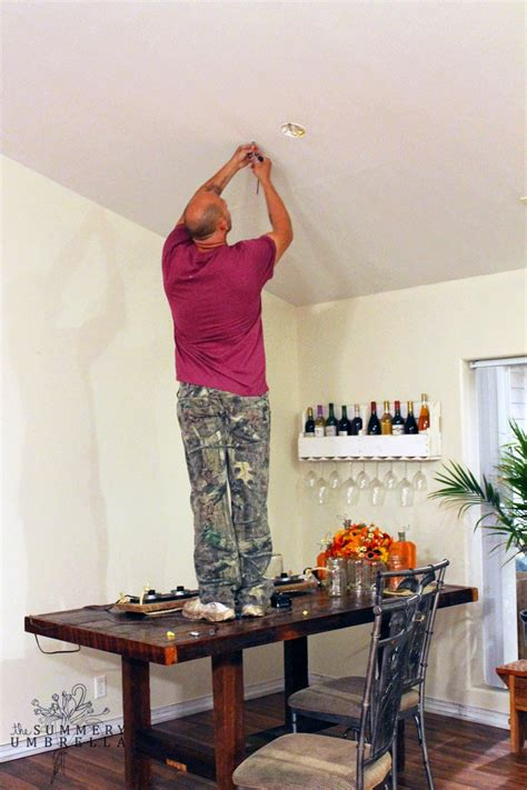 how to hang a l from the ceiling remodelaholic upcycle a vanity light strip to a hanging