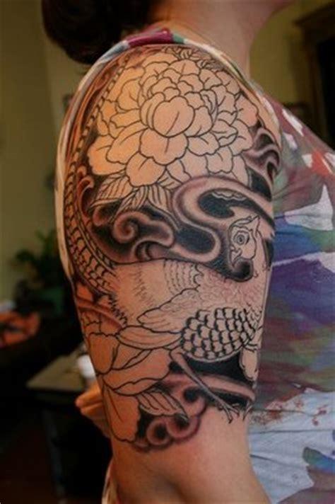 grey ink swirl and rose flower half sleeve tattoo grey ink japanese flower half sleeve tattoo