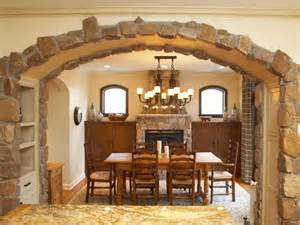 country dining room with stone arch to give this formal