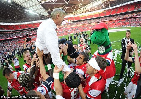 arsenal wins the fa cup final after crushing chelsea sports arsene wenger forced to go topless after arsenal team soak